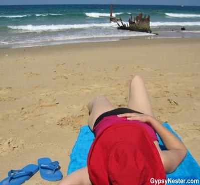 Veronica lounges at Dicky Beach, Caloundra, Queensland, Australia! GypsyNester.com