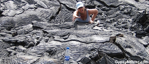 The tropical sun on the black basalt flow takes a toll on Veronica.