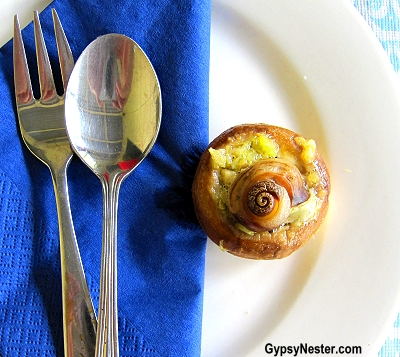 A lightly cooked, nutritious snail in a mushroom at Glasshouse Gourmet Snails in the Hinterlands of Queensland, Australia