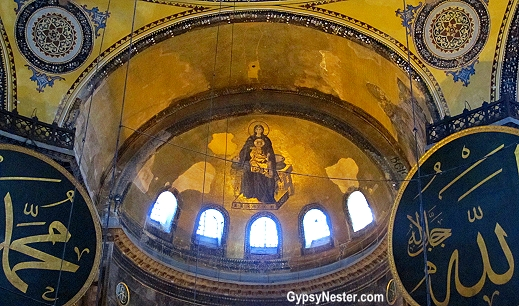 Christian and Muslim art is displayed side by side in Hagia Sophia, Istanbul, Turkey