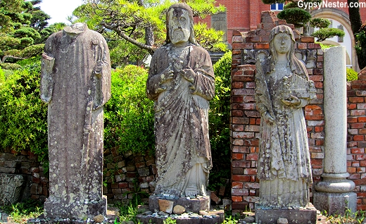 Statues that survived the atomic bomb at Urakami Cathedral in Nagasaki, Japan