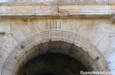 Roman numerals above each of the archways mark the entries leading into the seating area at the Colosseum