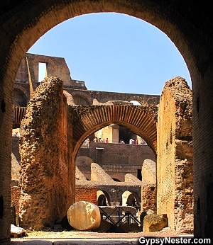 An arched entry to The Colosseum in Rome, Italy