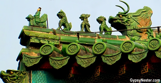 Small statues adorn the corners of the building roofs at The Temple of Heaven in Beijing, China. The more figures, the higher the status of the building.
