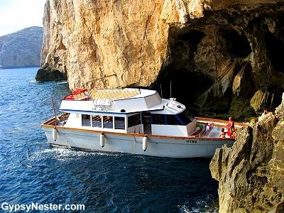Boat at the entrance of Neptunes Grotto, Sardina