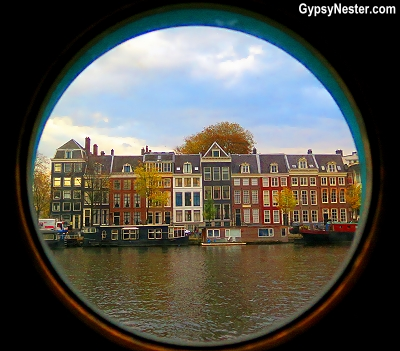 The view from our porthole in our beautiful houseboat bed and breakfast on the Amstel River in Amsterdam, Holland