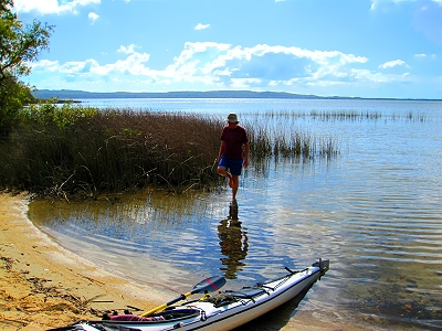 David stands in Lake Cootharaba to kayak to the Queensland Everglades