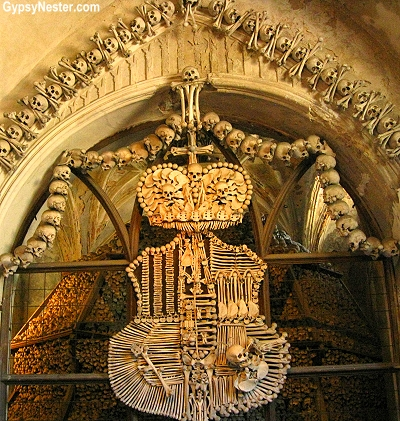 The Schwarzenburg family coat of arms made of human bones at the Sedlec Ossuary in Kutna Hora, Czech Republic