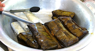 Tamales wrapped in banana leaves, Belize City