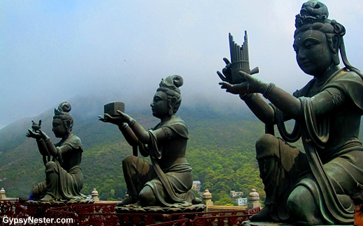 Three of the six devas offering gifts to the Big Buddha in Hong Kong