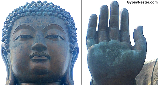 Close ups of the head and hand of the Big Buddha in Hong Kong China