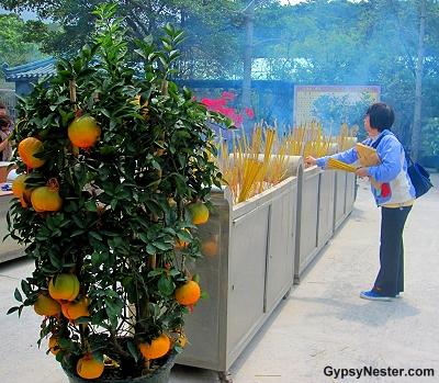 Incense offering at the Big Buddha in Hong Kong, China