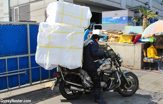 Amazing amounts of stuff are loaded on motorcycles in Buson, South Korea