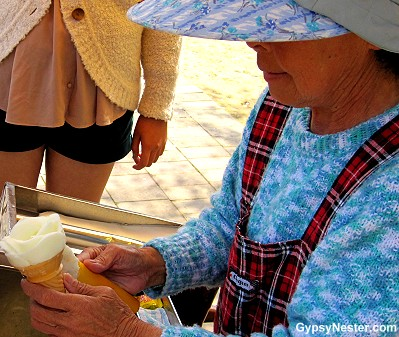A woman creates a perfect rose out of ice cream in Nagasaki