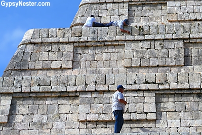 Restoration work being done high atop the pyramid at Chichen Itza in Mexico