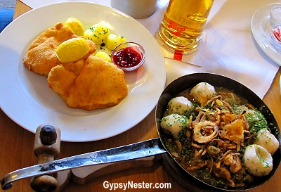 the local bräu, Stiegl, but also excellent authentic dishes. Not having had a schnitzel yet, that was a must, and when we saw six stuffed dumplings mit sauerkraut on the menu we knew what we had to do