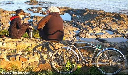 A couple enjoys yerba mate on the beach in Colonia Uruguay