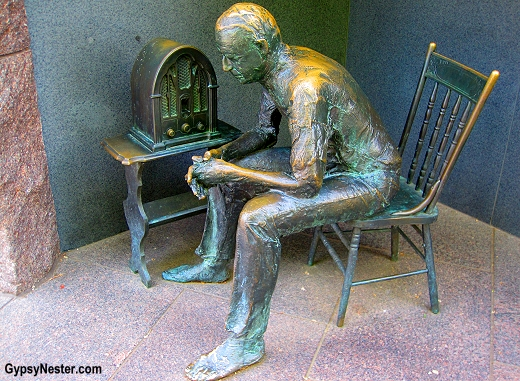 A man listens to a fireside chat on the radio in The Roosevelt Memorial in Washington DC
