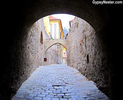 Dark tunnel leading inside medieval walls in Durnstein, Austria in the Wachau Valley