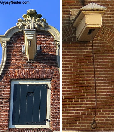 In Amsterdam, because the houses are so tall and skinny, almost every house has hoisting beams attached above the highest windows. This way furniture or heavy repair materials can be pulled up and brought inside through a large window. Think piano movers in an old silent movie, that's the idea