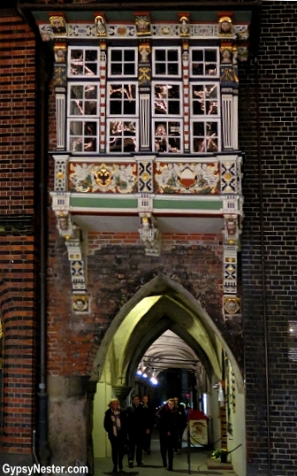A whimsical balcony at Lübecker Rathaus town hall in Germany