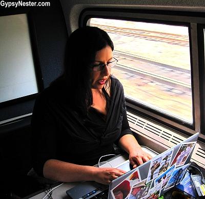 Veronica surfs the internet on a train! GypsyNester.com