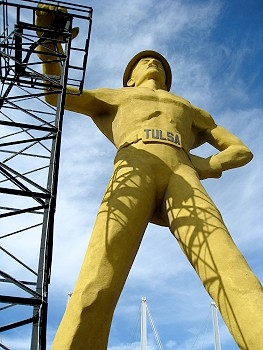 The Golden Driller of Tulsa is straight out of 1953, standing 76 feet tall and resting his 43,500 pound bad self against a real oil derrick