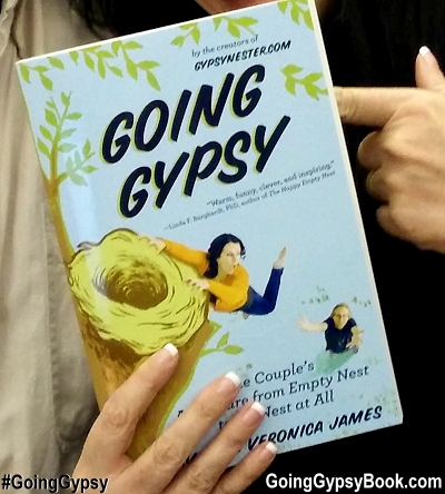 Close up of Veronica holding Going Gypsy: One Couple's Adventure from Empty Nest to No Nest at All!