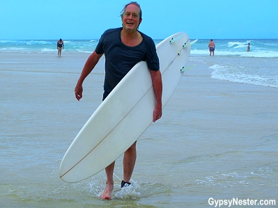 David gives surfing a go on Kurrawa Beach in Gold Coast, Queensland, Australia