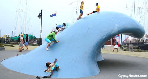 Children playing on the art on the boardwalk in Halifax, Nova Scotia, Canada