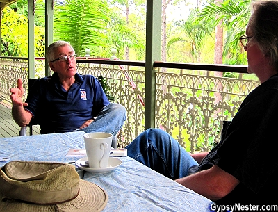Cliff of Glasshouse Gourmet Snails speaks to The GypsyNesters on his Queenlander porch in the Hinterland of Australia