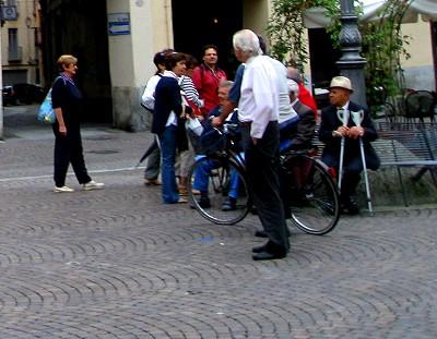 Old gentlemen watching in Italy