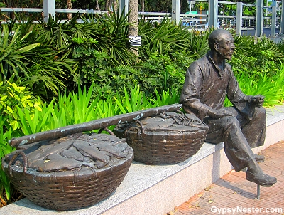 Statue of a fisherman and his catch on the Aberdeen Promenade in Hong Kong
