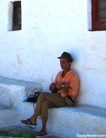 A musician in Mykonos, Greece