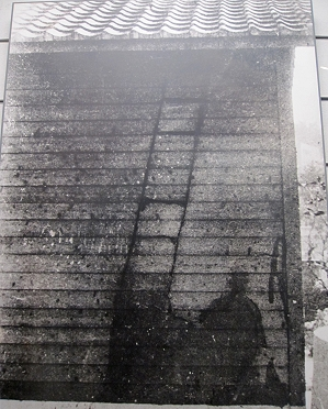 Silhouetee of a man and his latter on a wall in Nagasaki