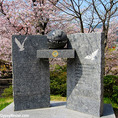 People at Peace monument at Nagasaki's atomic bomb ground zero