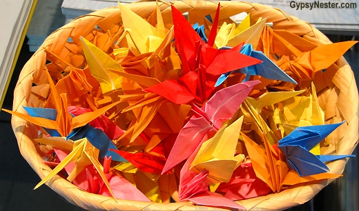 Paper cranes hung in strands of a thousand each are offered by individuals wishing for peace in Nagasaki