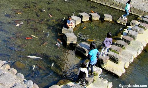 Children play near the Spectacle Bridge in Nagasaki, Japan