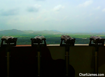 Looking through binoculars at the DMZ in Korea