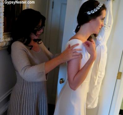 Veronica helps The Piglet into her wedding dress