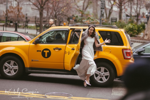 The Piglet arrives in a taxi at City Hall on her wedding day