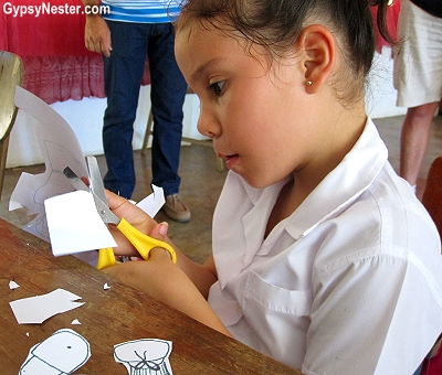 A child does her schoolwork at a palm plantation school in Costa Rica
