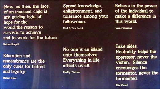 A sign filled with quotes on the inside of the train car at the Children's Holocaust Memorial in Tennessee