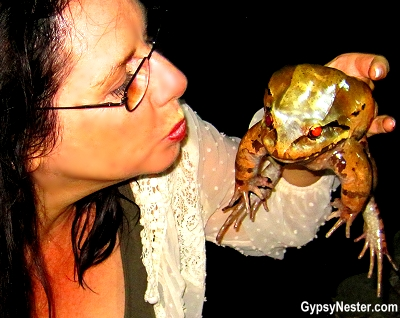 Veronica kisses a frog at Parador Resort and Spa in Quepos, Costa Rica