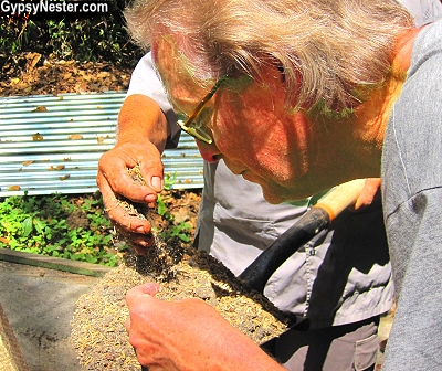 David examines the soil at Parador's composting center in Costa Rica