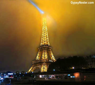 The Eiffel Tour in the fog at night in Paris, France