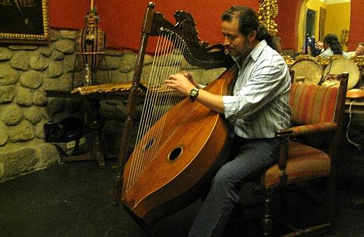 Gustavo plays a harp in Cusco Peru
