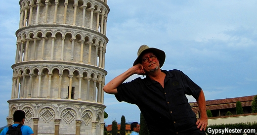 Holding up the leaning tower of Pisa... casually