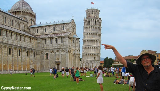 Holding up the leaning tower of Pisa with one finger!