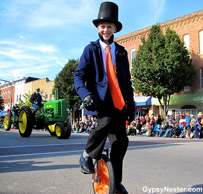 A boy ride a unicycle in the Pumpkin Fest parade in Sycamore, Illinois